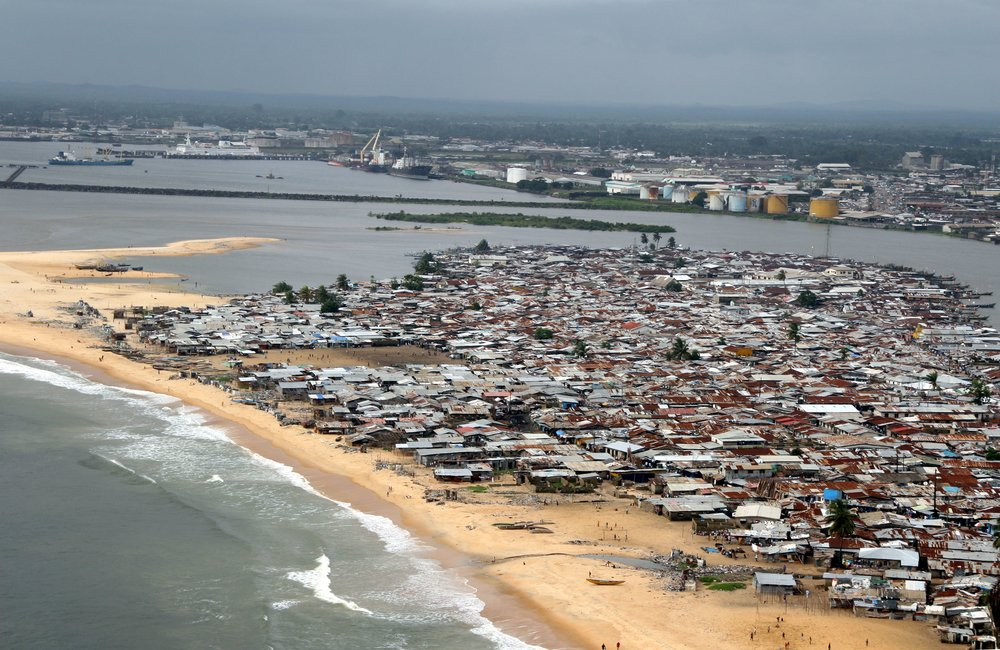 A garbage-choked stream of effluent flows out to the sea between corrugated toilet shacks in West Point, a slum area in Liberia's capital Monrovia on 4th August 2007.  West Point is a vast slum, home to over 75,000 people. The West Point peninsula is thre