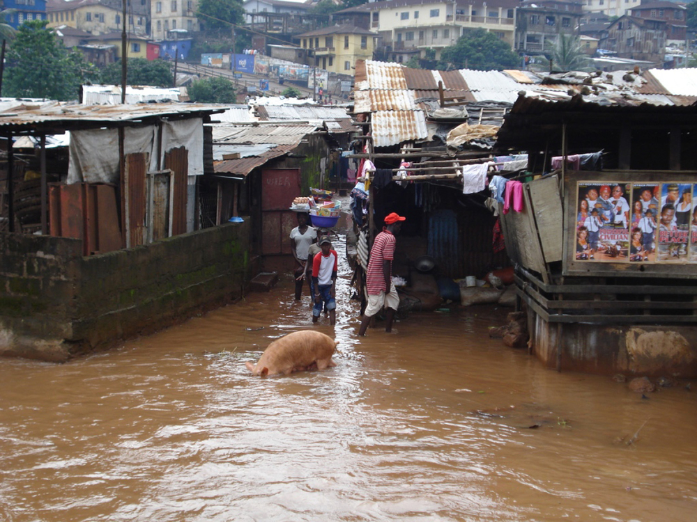 Children had to walk through water to go to school after flooding in Kroo Bay slum in Freetown, Sierra Leone, Spetember 2007.