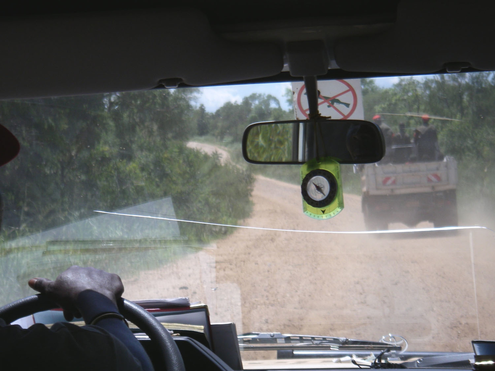 An SPLA armed escort in a truck travels ahead of a vehcile of the NGO Merlin to provide protection against possible LRA attack. NGO and UN operations have for years been hampered by insecurity caused by the LRA in southern Sudan.