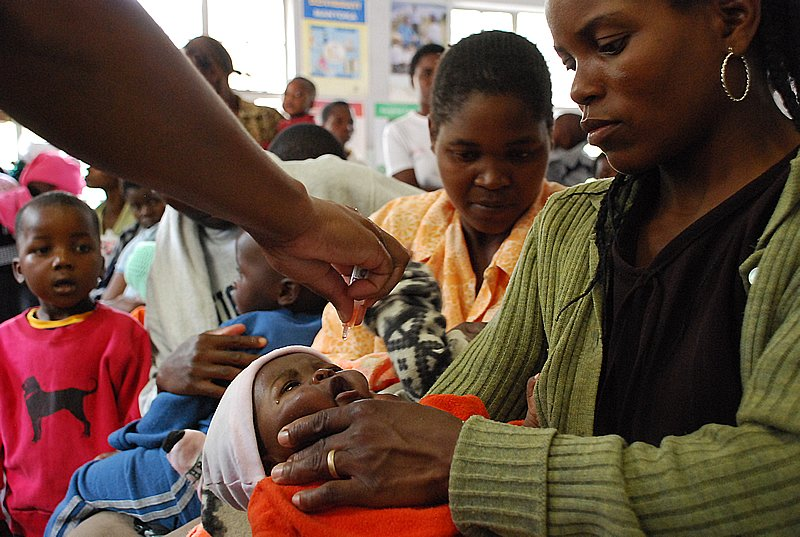 An unidentified mother from Mbare holds her baby as they receive the polio vaccination. According to UNICEF, since the implementation of (CHDs), Zimbabwe has not reported a single case of polio since 1990 and reported cases of suspected measles have dropp