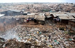 [Kenya] An overview of Kibera slums in Nairobi, Kenya, 30 January 2007. Kibera is one of the largest slums in Africa, housing an estimated one million people. Canals, rubbish dumps, sewage systems and a railway line criss-cross the mostly corrugated iron