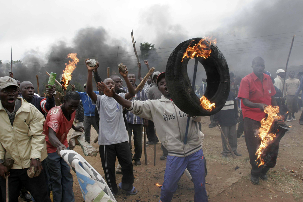 A group of youth demonstrates against the results of poll results, Kenya. December 2007. Post election violence has rocked most parts of Kenya.
