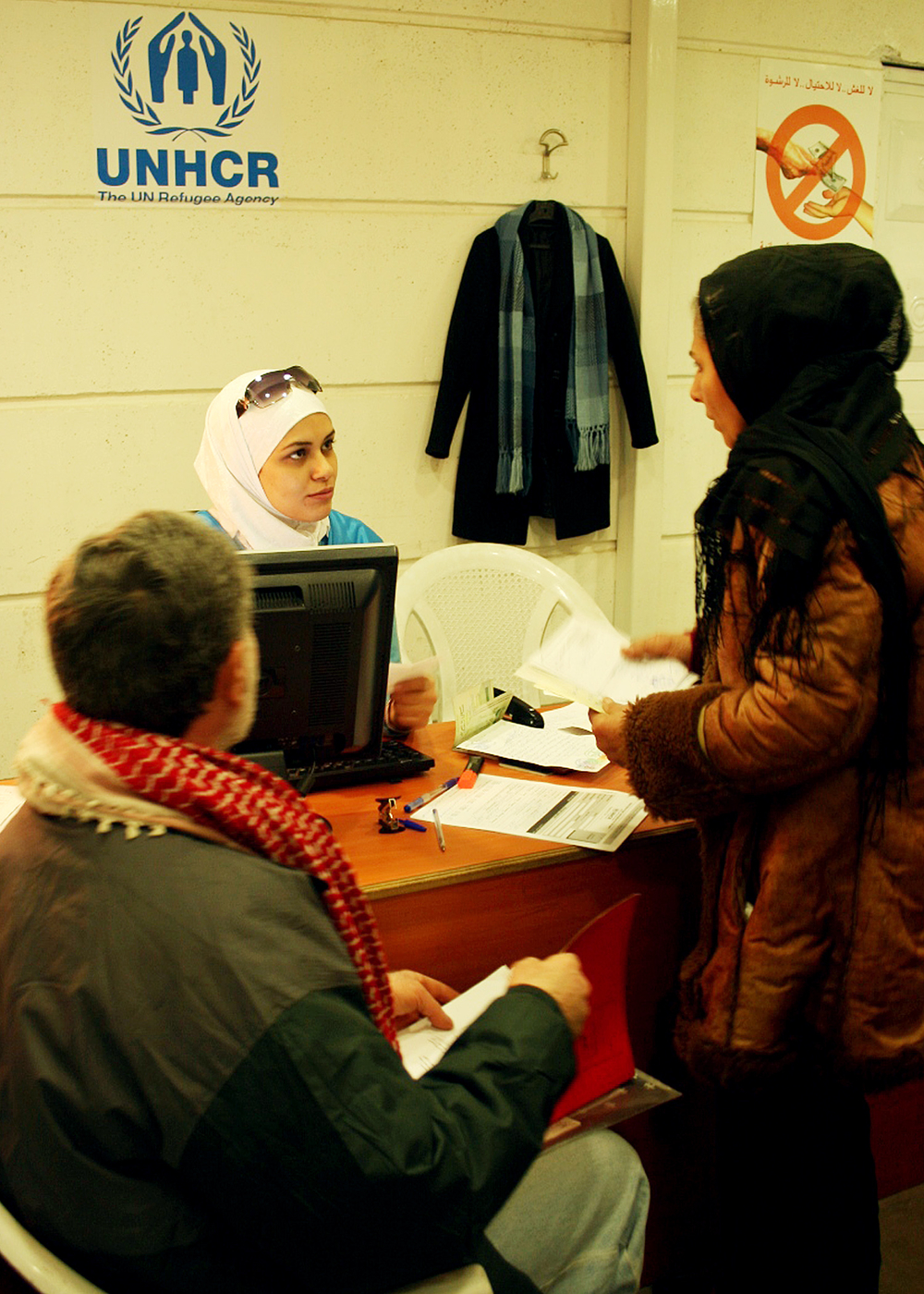 Iraqi refugees register at the UNHCR centre in Damascus. New figures reveal that refugees are suffering extremely high levels of trauma from the violence at home and their difficult circumstances in Syria.