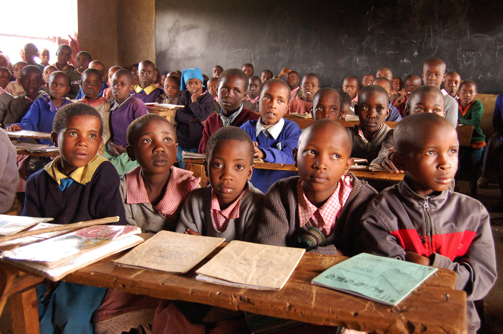 Children in a crowded class at the Moto primary school, Molo town, Rift Valley Province, Kenya, February 2008. It is one of the few schools to have re opened in the area following the post-election violence in Kenya, and is having to deal with over-crowde
