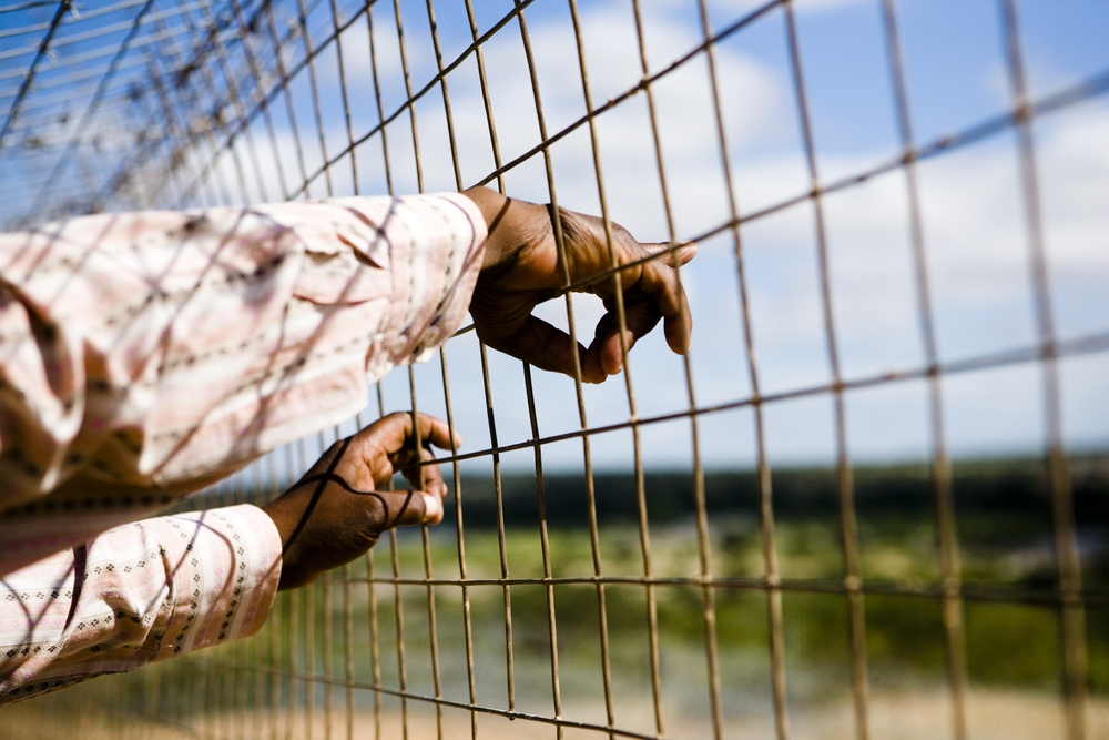 "At the border fence: Peter is a ""transporter"", helping Zimbabwean migrants across the border. He says people swallow their fear because they have no alternative. Click here for more.. 270220082.mp3"