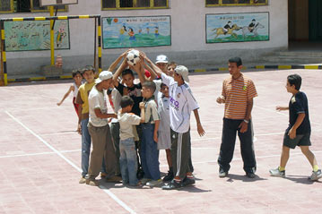 Refugee children play at a school in 6th of October City near Cairo. Doctors say Iraqi refugee children have health problems unique to their population.