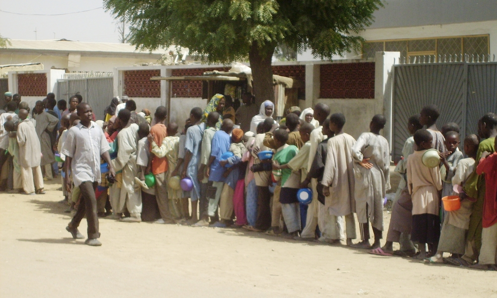 Child beggars queue for food in Kano.