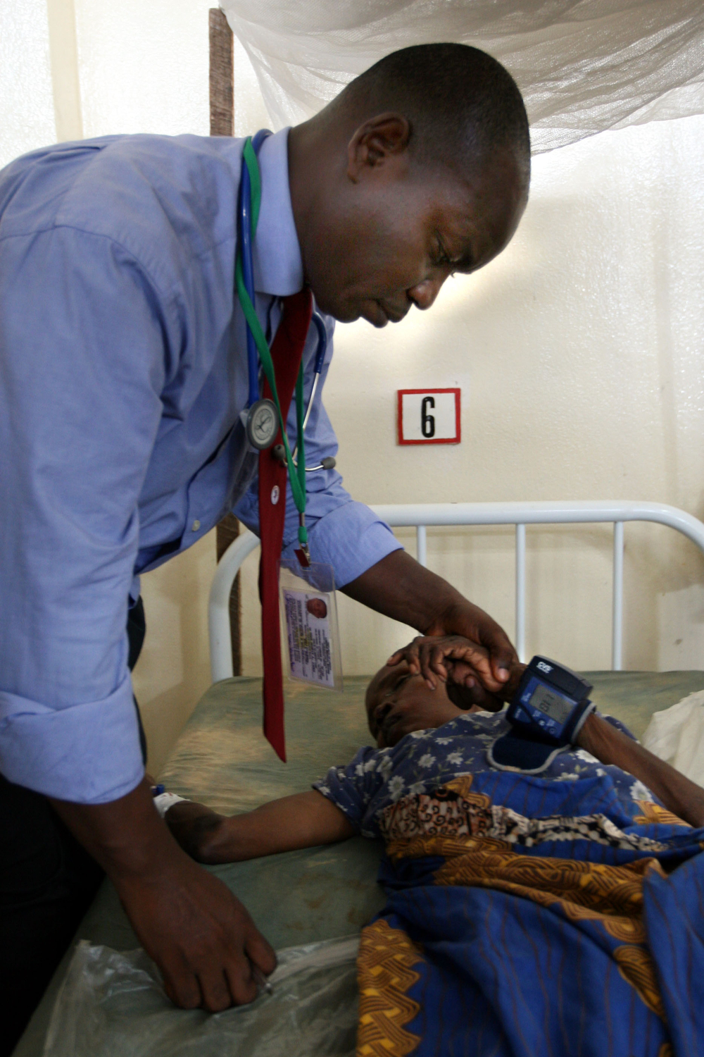 A Nigerian doctor checks an elderly female patient's blood pressure at Redemption Hospital, Monrovia, Liberia on 26th March 2008.   Medecins Sans Frontiers pulled out of the Redemption Hospital in early 2007 bringing an end to free treatment, as a result