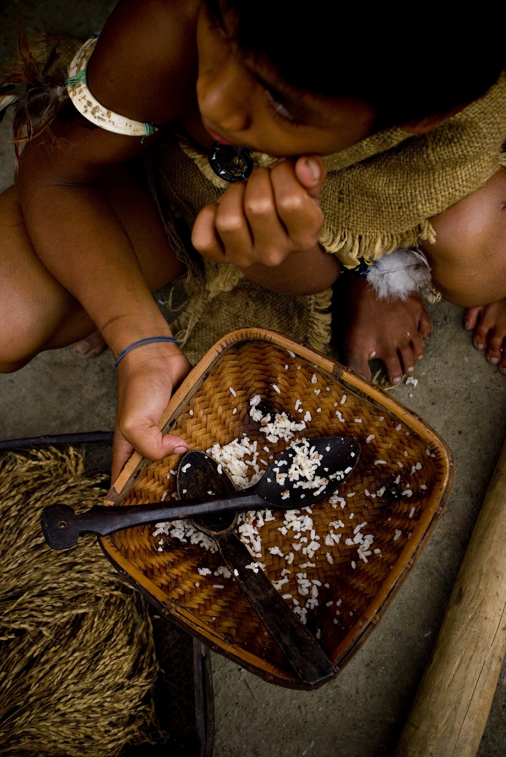 A young boy eats in a native plate of locally grown rice in Banaue in Ifugao Province north of the Philippines May 2008. The recent culmination of the Imbayah rice festival heralds the bountiful harvest in what is considered the 8th wonder of the world. B