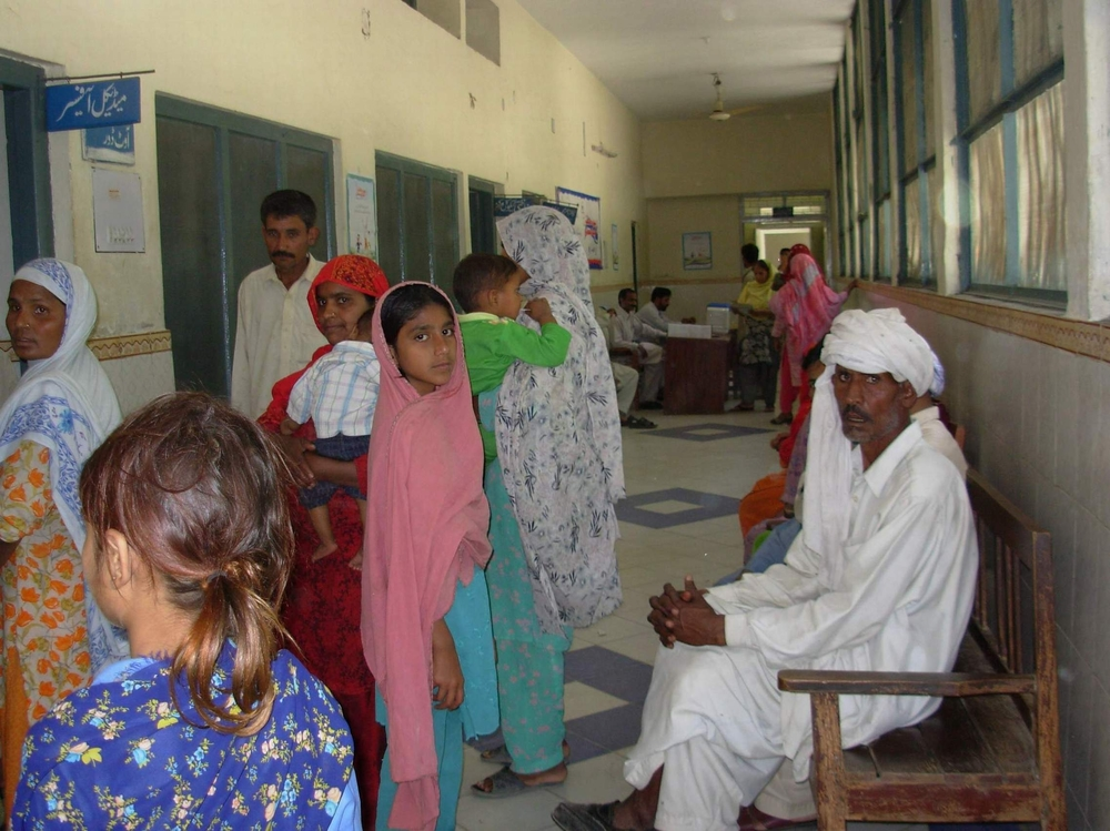 People wait to receive medication at a government health centre but the fact most of them are illiterate has a major impact on their welfare.