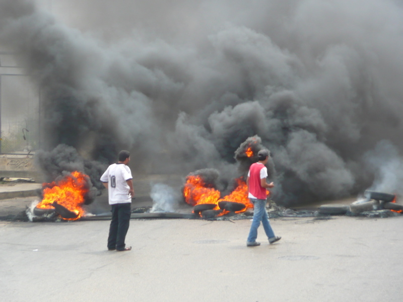 Supporters of the Hezbollah-led opposition burn tyres to pressure the western-backed government.