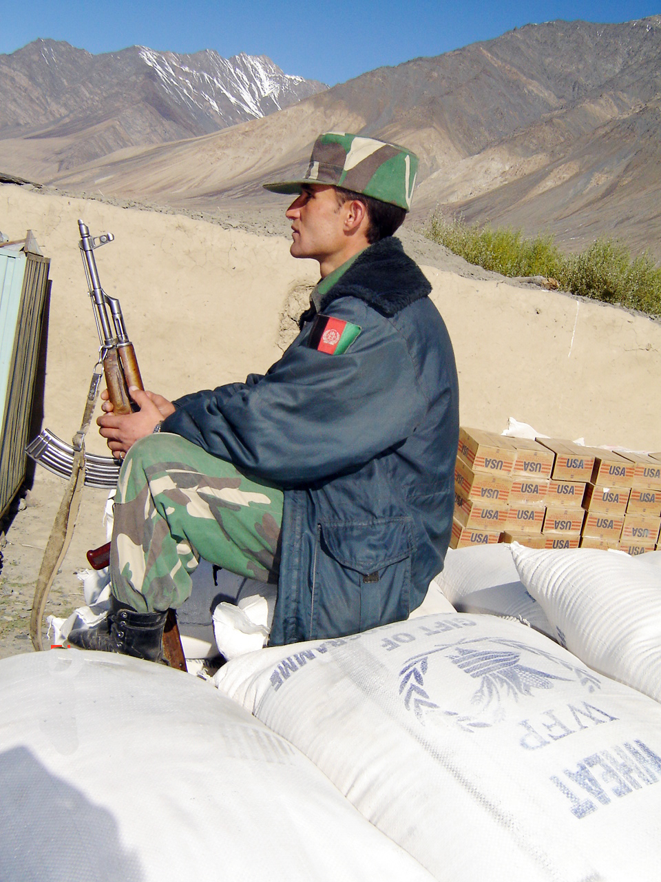 An armed guard travels with a previous WFP food consignment.