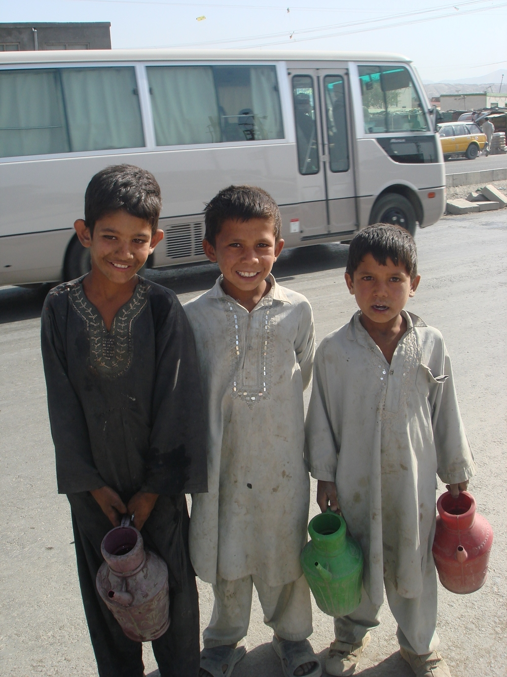Children selling water in Kabul. Rights watchdogs say children who work in restaurants and other public places are particularly vulnerable to sexual abuse.