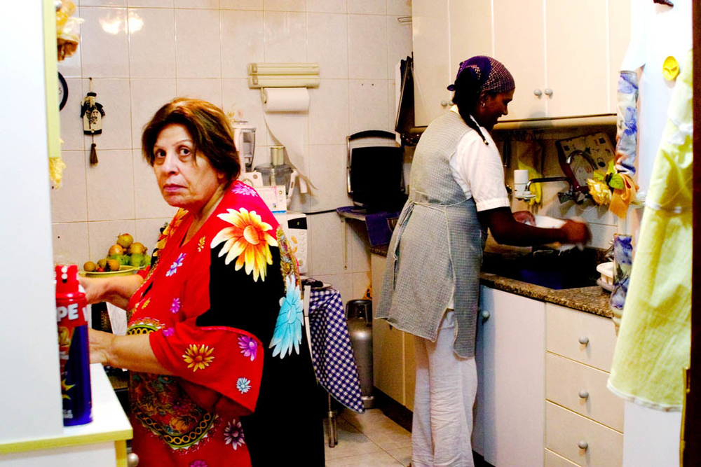 Standing in a Beirut kitchen with her 'Madame', Elsa, a domestic worker from Ethiopia, washes the dishes after the evening meal.