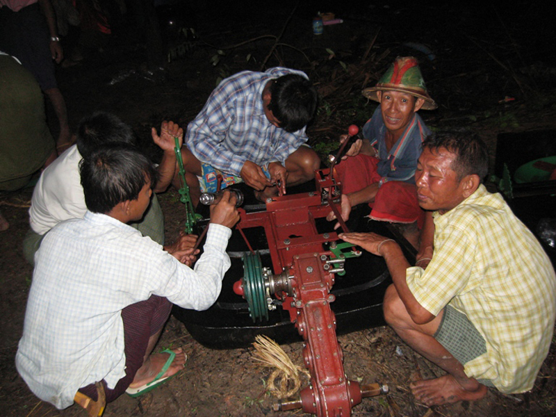 Farmers in Myanmar's cyclone-affected Ayeyarwady delta struggle to put together a power tiller. Thousands of farmers lost their equipment to Cyclone Nargis in May 2008.