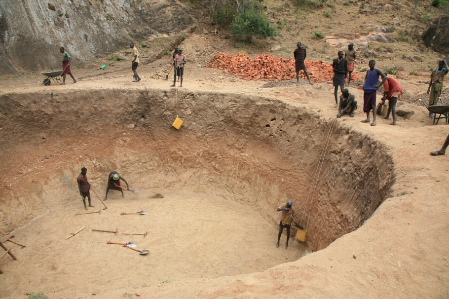 Several NGOs and other organizations are trying to do development projects in Karamoja, like this one, where men are paid to build rock catchments for holding water. The Karamoja region of Uganda, near the border of Sudan and Kenya, has not seen as many d