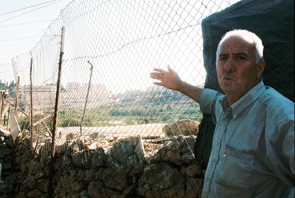 "Sami Gheit, a 62-year-old farmer, said he lost 50 dunams (five hectares) of his land to a ""buffer zone"" created by the Israeli military between his home and the nearby settlement of Qiryat Arba."