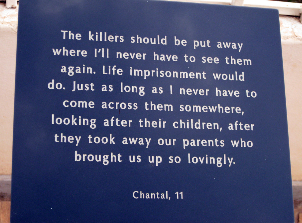 a plaque at the Kigali Memorial Centre. The Centre is built on a site where over 250,000 people are buried.
