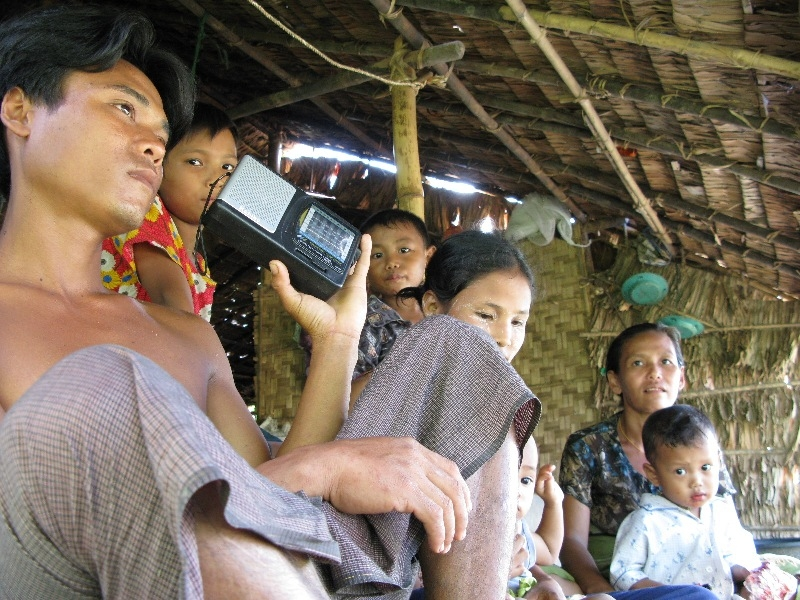 Kyaw Kyaw and his family in cyclone-affected Kunchangone southern Myanmar listen in to the latest news and information.