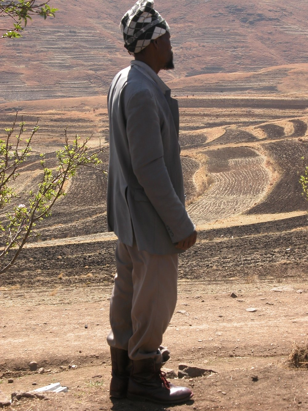 Chief Paulosi Lebakeng of Ha Tsui looks over the dry fields around his village.
