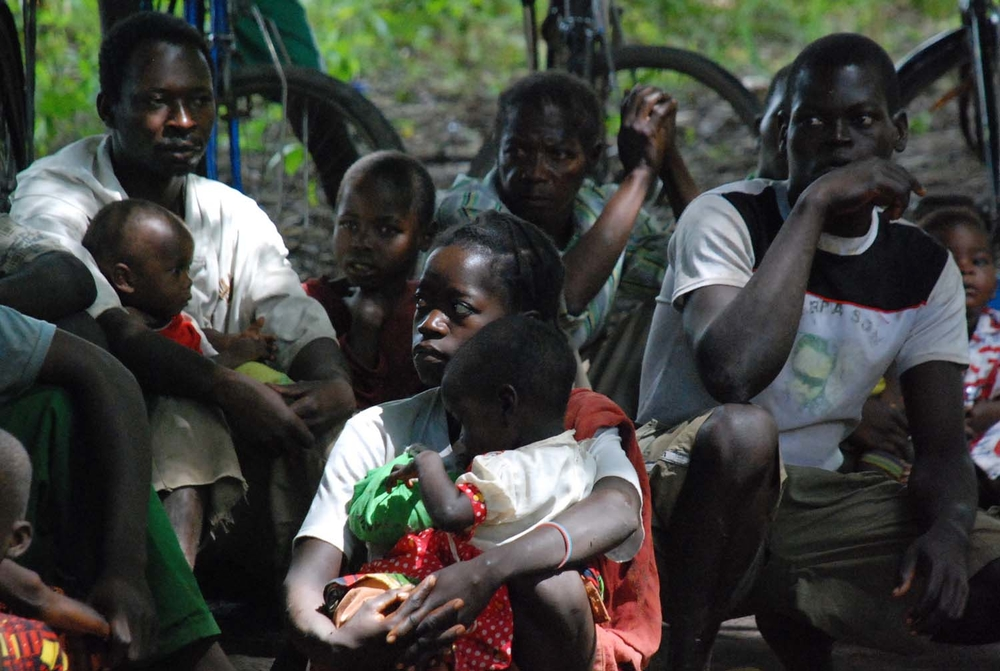 Refugees from the DR Congo fleeing LRA rebel attacks wait to register  with