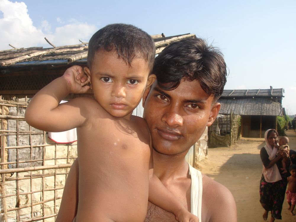 A young Rohingya man and his son at the Kutupalong refugee camp in southern Bangladesh. There are upwards 200,000 Rohingya refugees in the country, about 28,000 of whom are documented and live at two government-run camps in the area.