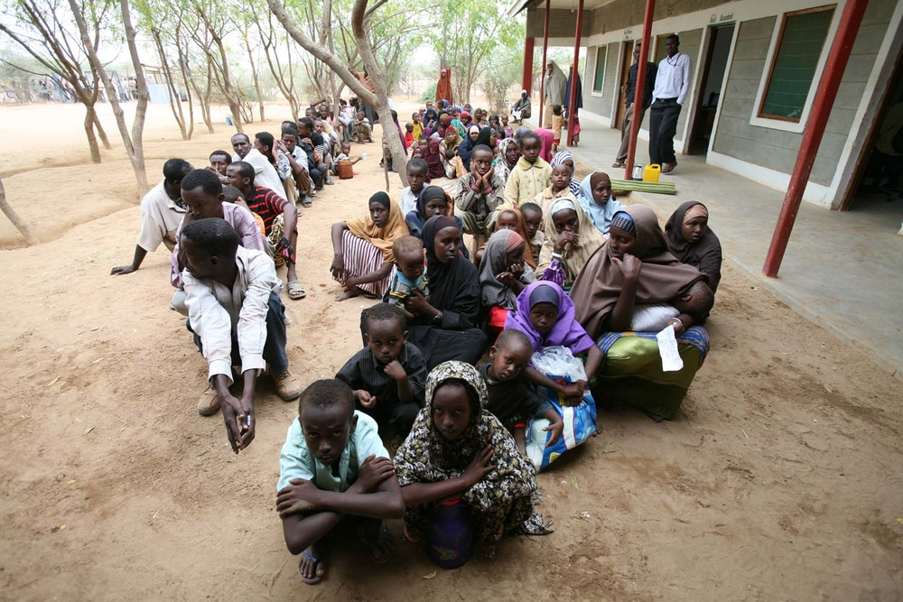 A group of Somali refugees waits to be registered by the UNHCR in Dadaab, Kenya, October 2008.
