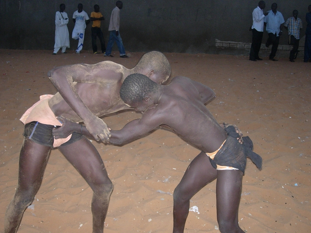 Youths in training at Ecole Balla Gaye, a centre for traditional wrestling in the Pikine neighbourhood of the Senegalese capital Dakar. Many say the traditional sport can be a path out of crime and poverty for youth