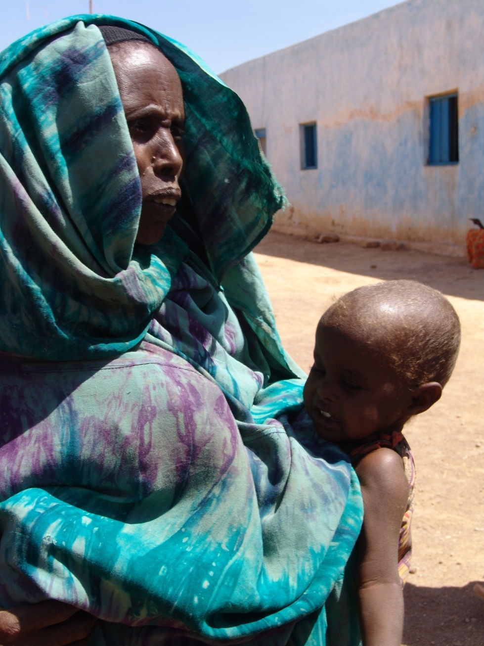 Mother of eight Mumina Bile Abdi trekked 50km to get help for her year-old twins at a supplementary feeding centre in El Berde, in southern Somalia's Bakook province. The journey from their village of Godgod took 30 hot days and cold nights.  Eight year