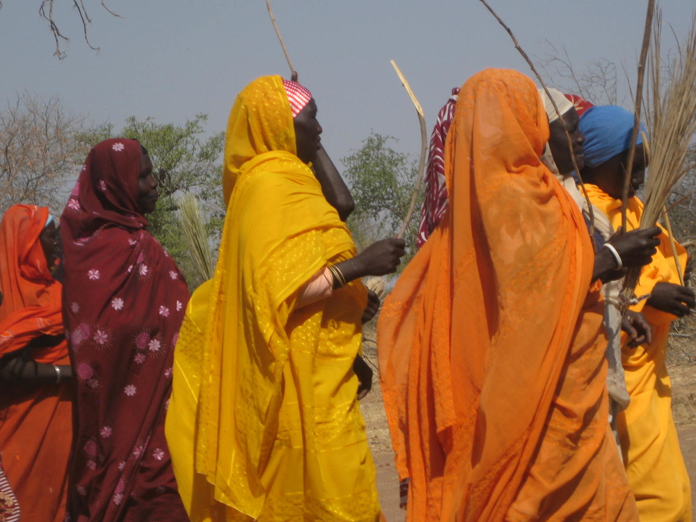 Local women dance in the village of Karkaraya Kayen located along the outskirts of the main town of Kadugli in Southern Kordofan state. The area is characterized by a lack of basic services as well as a poor road network
