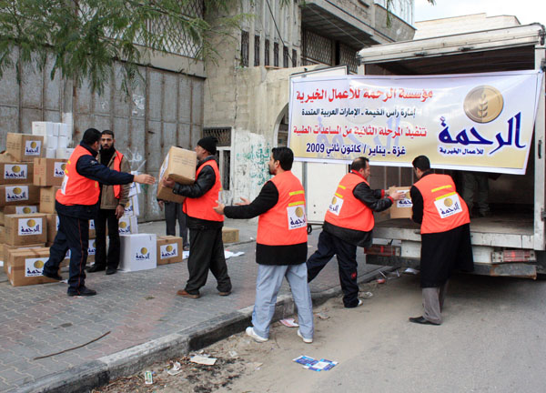 Aid workers unload desperately needed supplies in Gaza