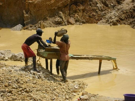 Gold miners in Ghana. A 2008 Human Rights Commission report stated communities living near gold mines were suffering human rights abuses and documented lack of compensation for land use and lost livelihoods
