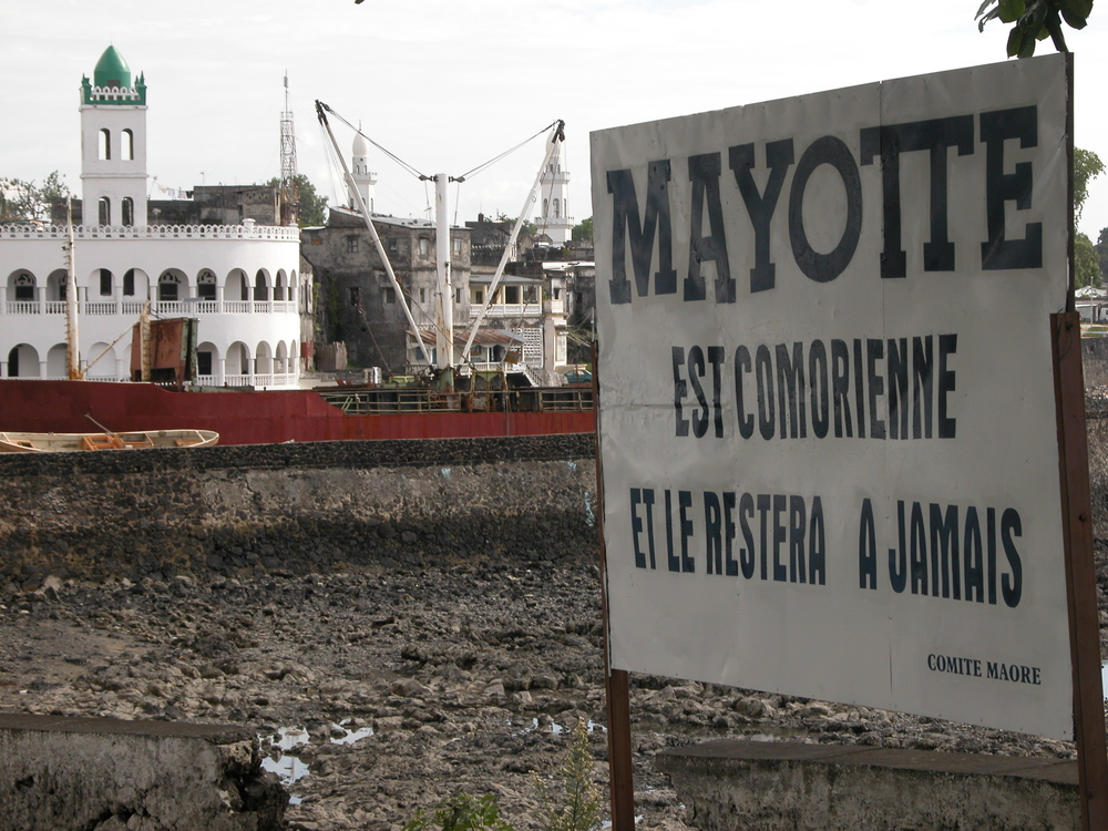"Comoros billboard protesting France's decision to incorporate Mayotte as a French overseas department. ""Mayotte is Comorian and will be forever"""