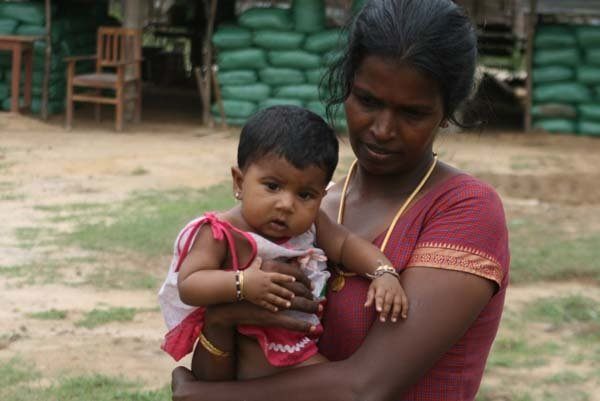 A Tamil mother and her child after fleeing the fighting in Sri Lanka's conflict stricken north