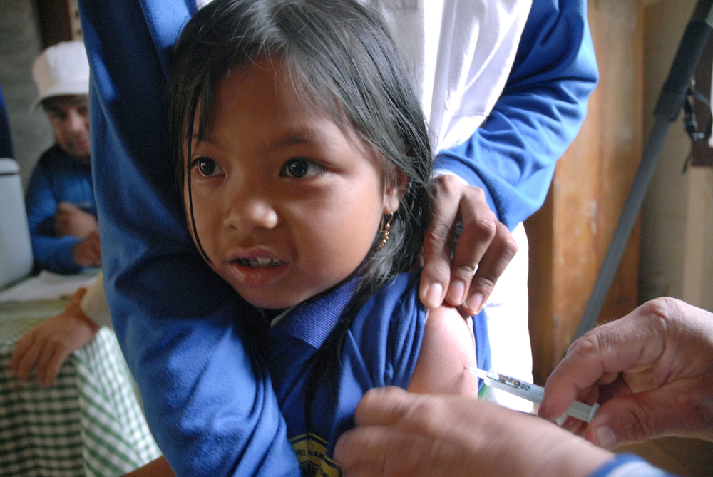 A kid has measles vaccination during UNICEF measles campaign vaccination at the remote jungle in Maratus Dayak community in the village of Haratai, Lhoksado sub district, Hulu sungai Selatan regency, South Kalimantan Indonesia, on August 10, 2007