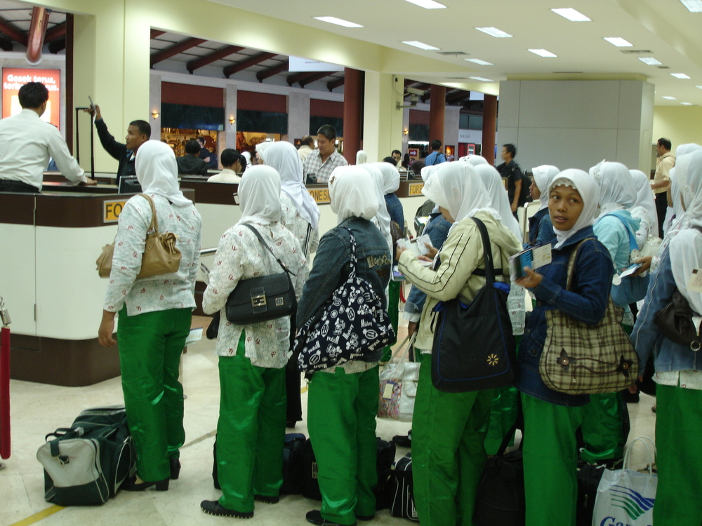 A scene at the Sukarno-Hatta International Airport in Jakarta. Thousands of women leave their homes in Indonesia to work as domestic workers each year. Approximately 80 percent of all labour migrants are women