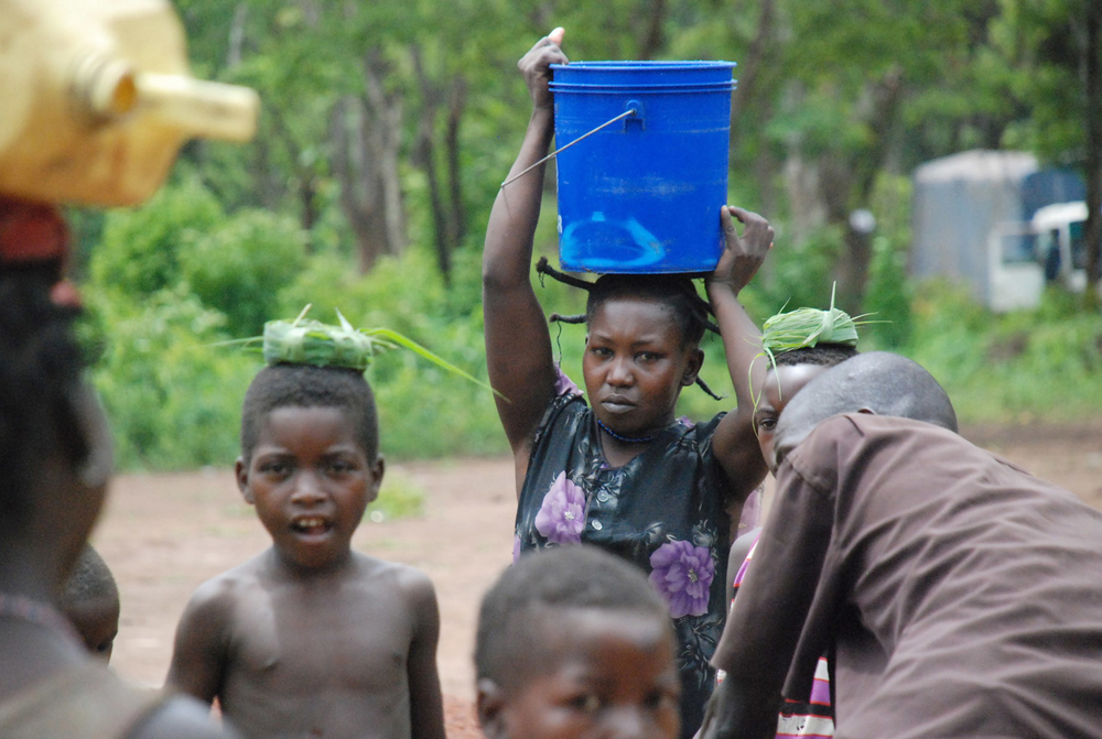 Refugees from the Democratic Republic of the Congo collect water at the Makpandu refugee camp in Southern Sudan's Western Equatoria region, in this May 2009 photograph. The refugees fled attacks from the LRA