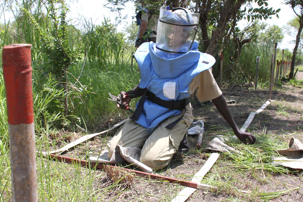 Deminer at work in a minefield in Bongo, near Juba. Women deminers are perceived as more accurate and reliable than their male counterparts