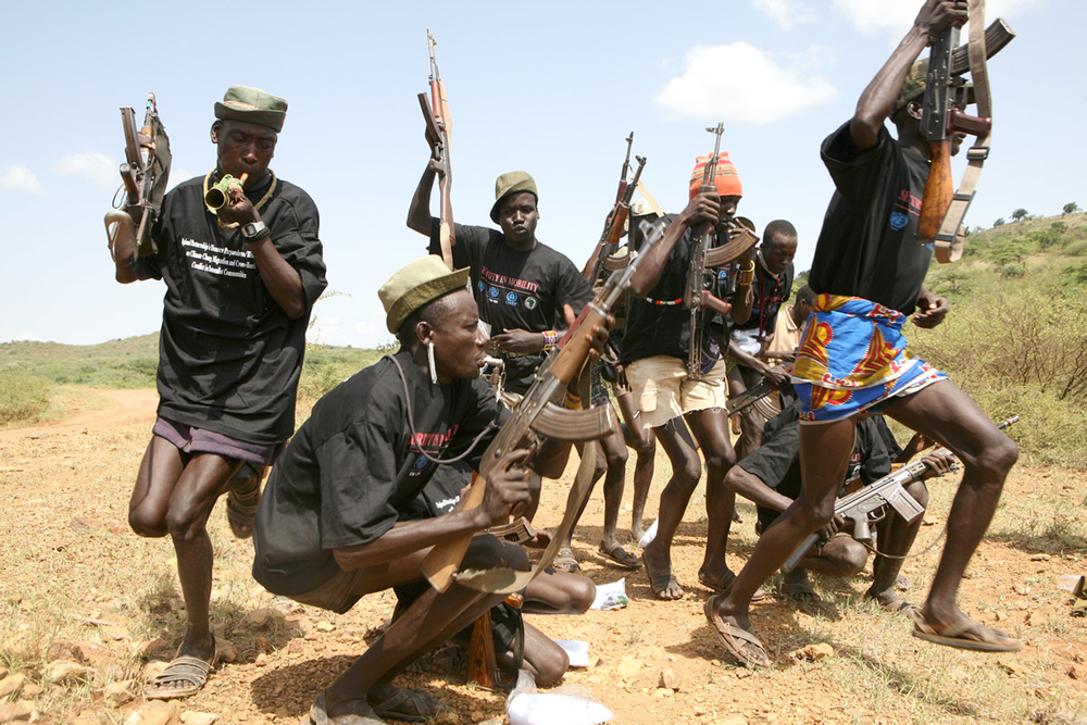 Turkana youths in northern Kenya, near the Sudanese border. Small arms such as the AK-47 are widespread among pastoralist communities in east Africa, where increasingly severe and unpredictable drought  has contributed to an increase in conflict between d