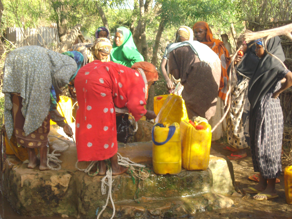 Women fetch water at a well in Isha, the only one in Baidoa town which still has water, the rest have dried up