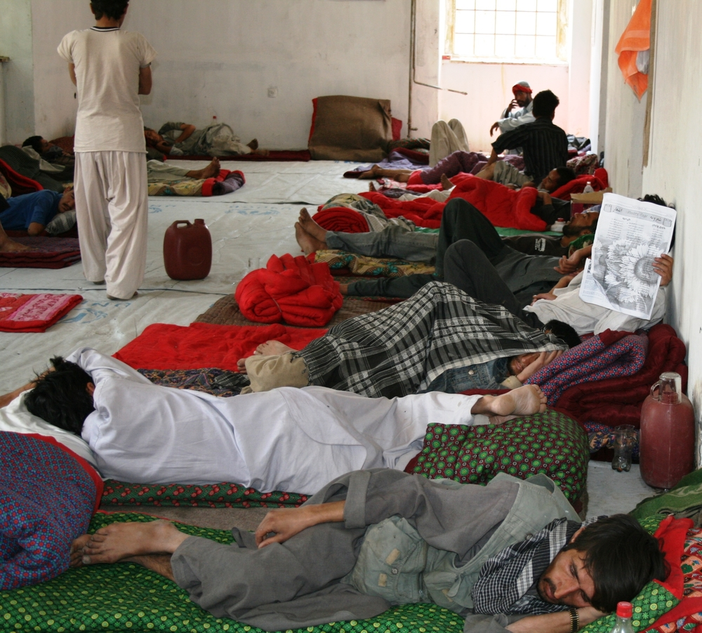 Drug addicts impatiently wait in the treatment centre for admission