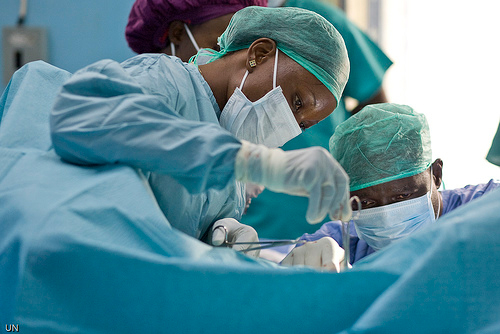 Female doctor performing an operation to correct Fistula