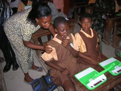 Children use laptops in Millennium Village supported school in Bonsaaso