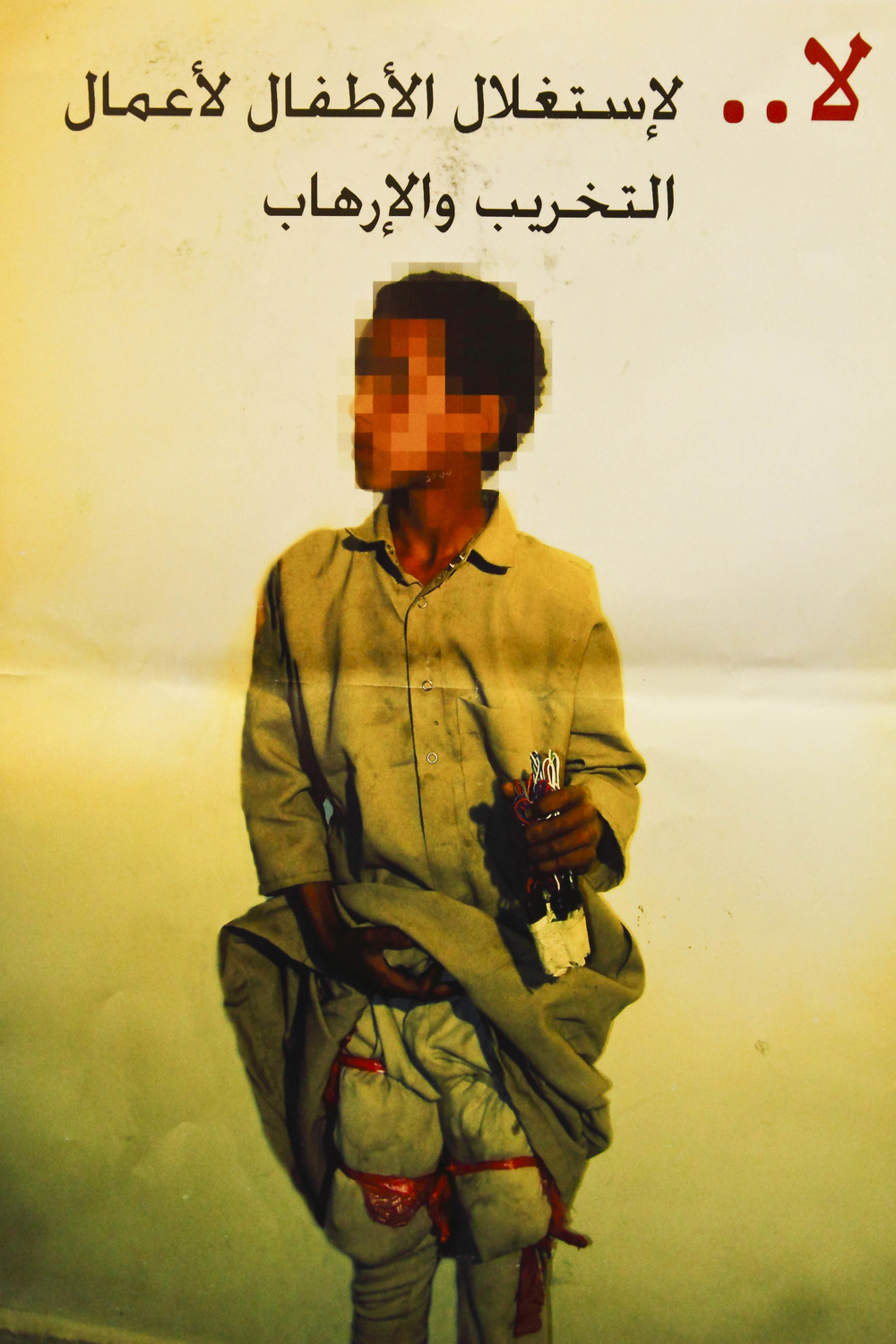 """No to the exploitation of children for destructive operations and terrorism,"" reads the poster of Akram"