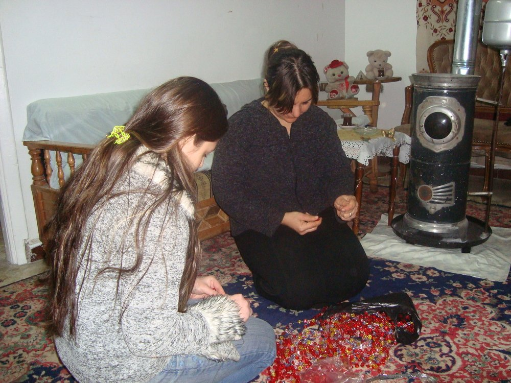 Aseel (left) and her mother working at home