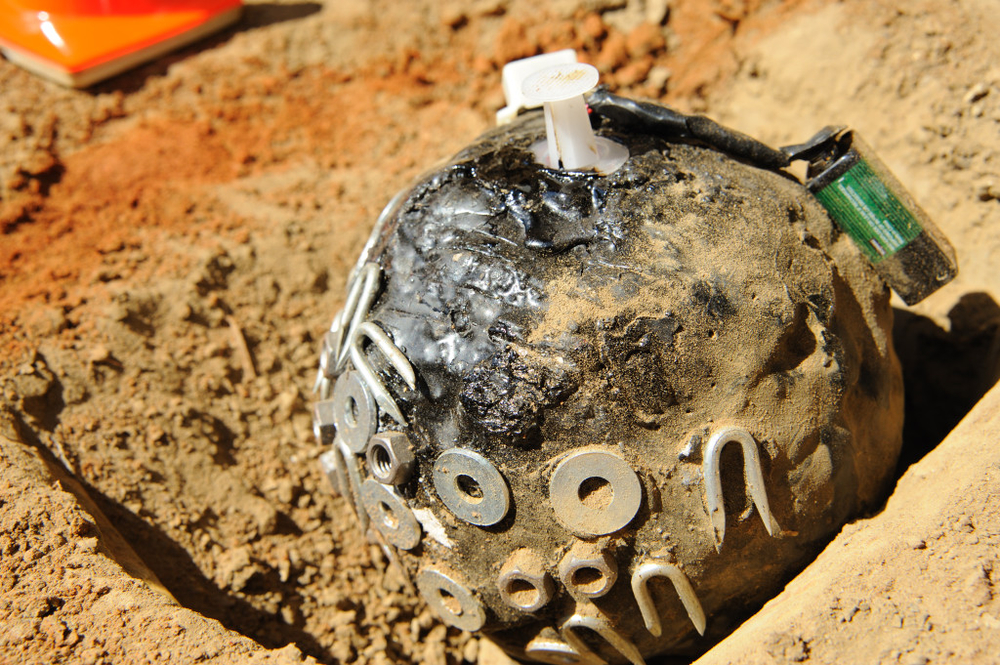 A home-made landmine, known as a ballon bomb. A syringe, attached to a 9 volt battery is used to detonate the device