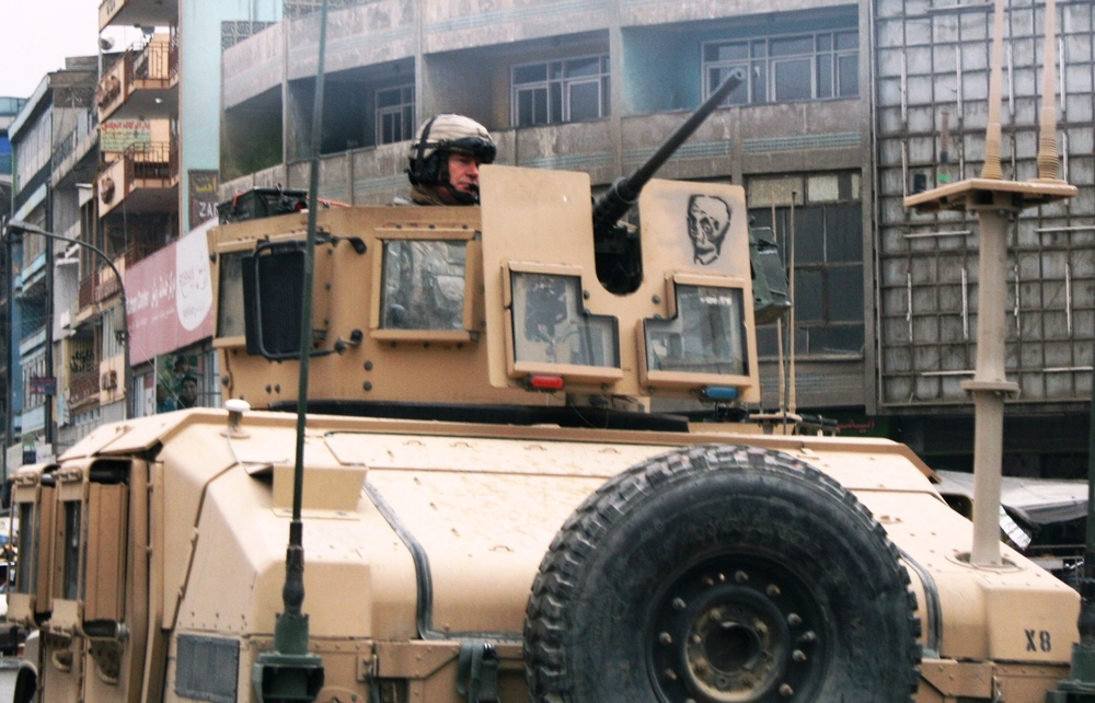US soldier at the top of a military vehicle in Kabul city