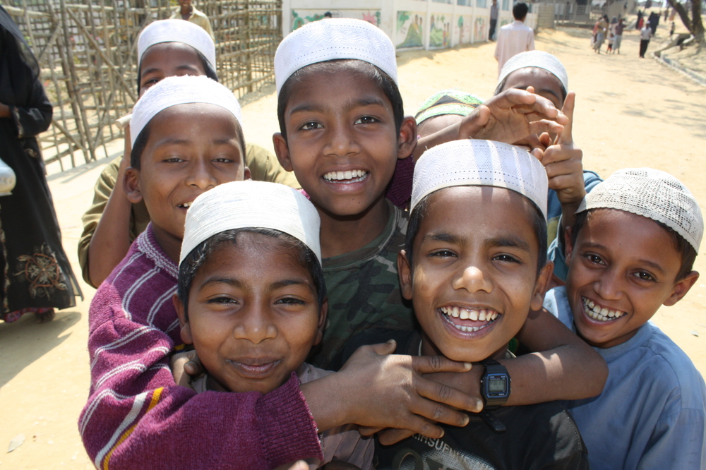 A group of boys smile to the camera at the  Kutupalong refugee camp outside Cox's Bazaar. There are 28,000 documented Rohingya refugees in Bangladesh