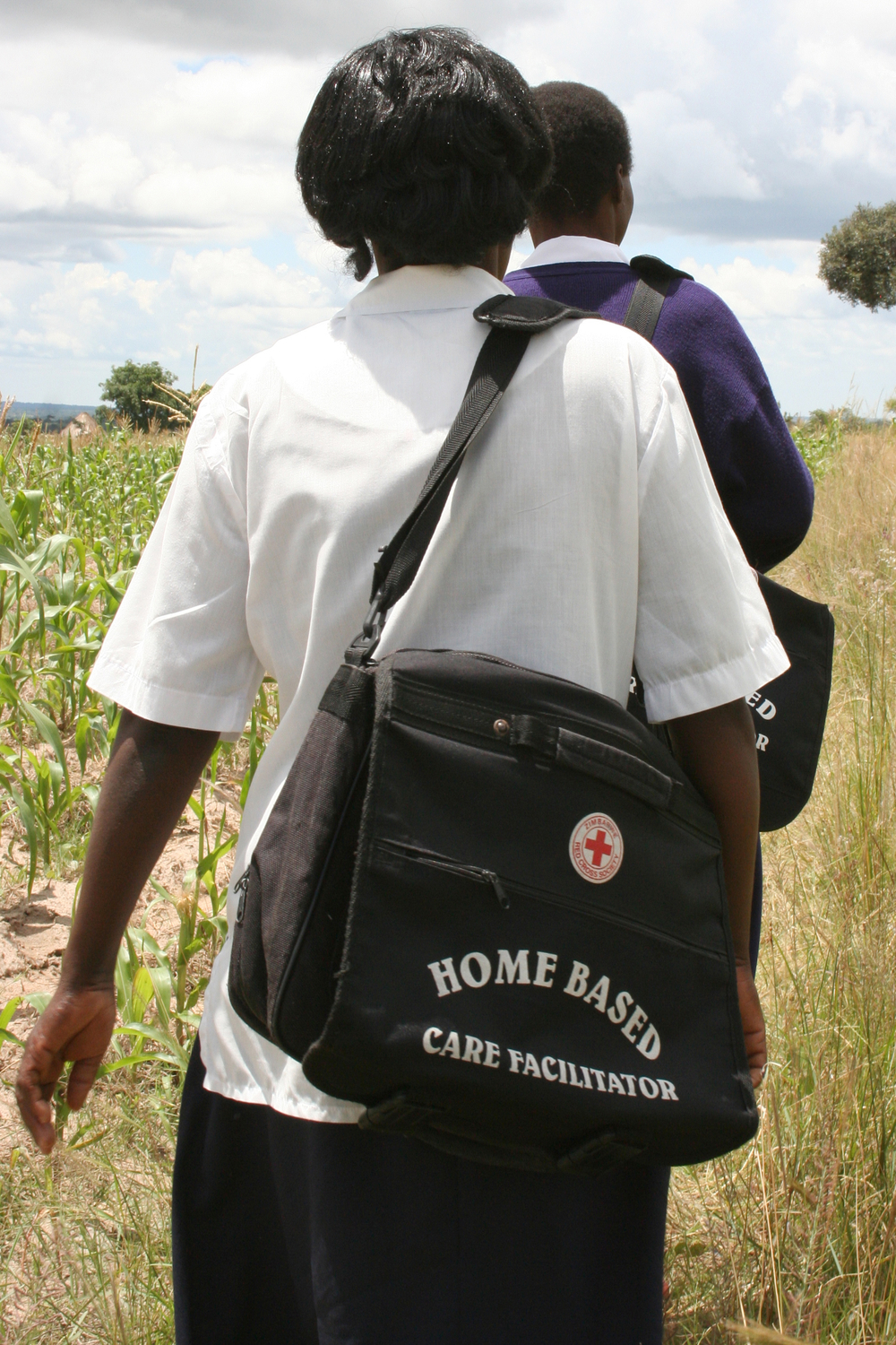Home based care workers on their rounds in Mashonaland, Zimbabwe. In southern Africa the volume of people infected and affected by HIV and AIDS has overwhelmed public health systems and social services. Community organisations, church groups and nongovern