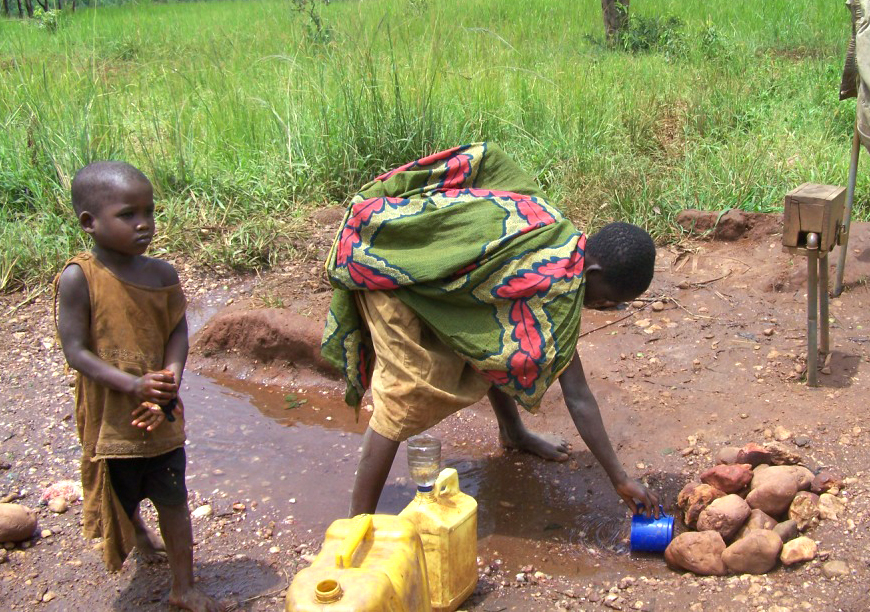 A girl comes to fetch water at Kukamakara peace village in Cibitoke province. The water tap on her side is functioning but she cannot afford the price